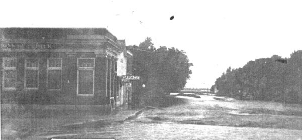 The State Bank of Porter and Art Speight's Auto Garage on the corner of Lone Tree Street and Brook Avenue in the Great Flood.