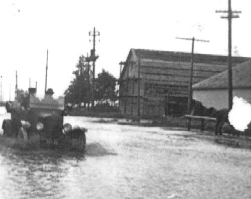 Driving into Porter on Lone Tree Street - Highway 68 from the East, the buildings still exist today and are part of the SMI & Hydraulics complex.
