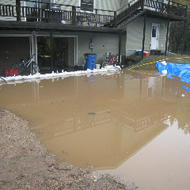 Flood waters begin to immerse the Syltie residence on South Brook Avenue as the Yellow Medicine River left its banks on Porter's South side.