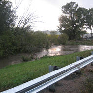The river approaches the Highway 68 bridge where it begins to spill over levies in all directions.