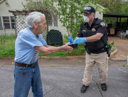 Mr. Don receives his meal from a Colbert Cty Deputy