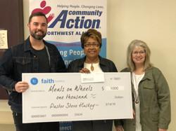 Faith Church Provides Lunch and Donation