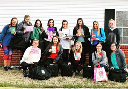 Alpha Gamma Delta delivers