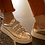 Thumbnail: Baskets dorées à scratchs tachetés