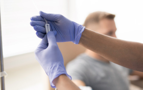 Hands-of-gloved-doctor-holding-part-4441