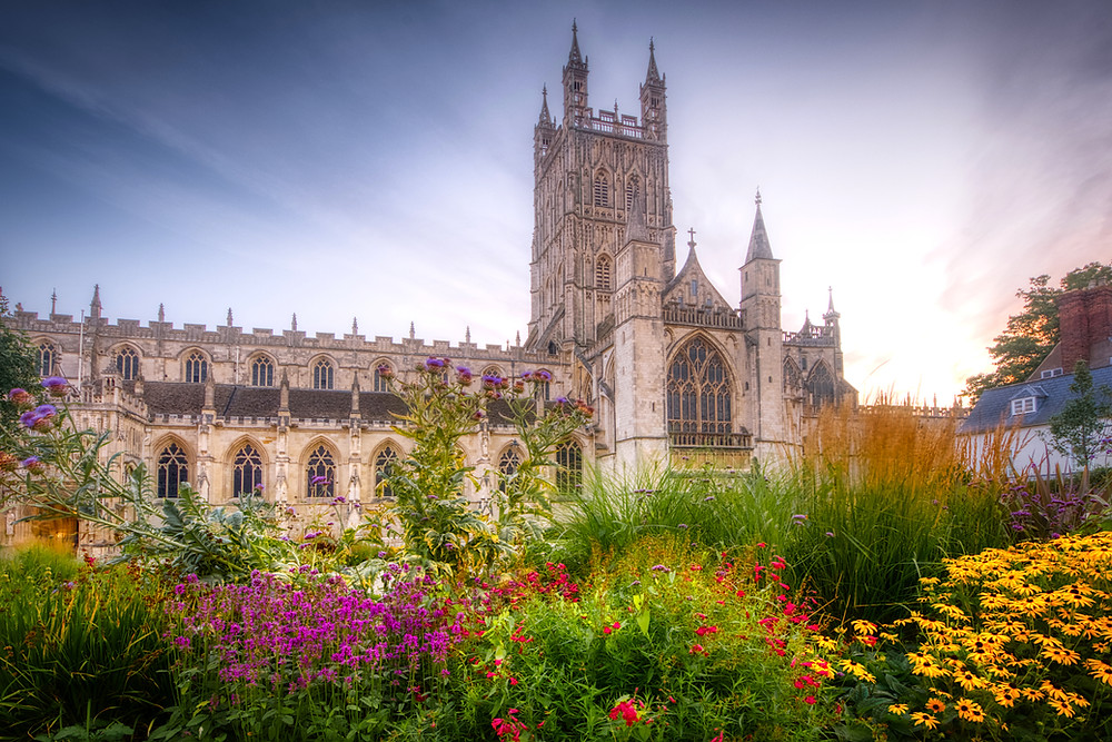 Photo of the cathedral with foreground filled by a garden of grasses and flowers