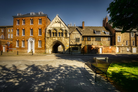St. Mary's Gate flanked by Monument House and no. 14 College Green