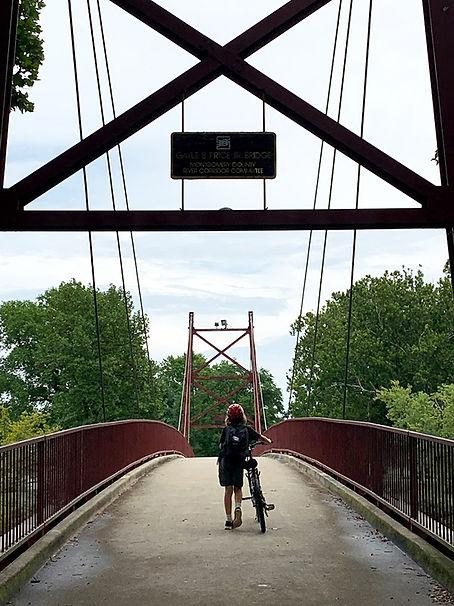 Crossing the Bridge at Triangle Park.jpg