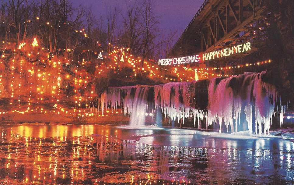 A post card from the writer's collection showing the falls lit up some time  in the 1980s. Christmas Greetings from Ludlow Falls - Mymiamicounty Ludlow Lights