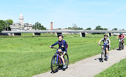 Kids on Bike Path with Courthouse in Bac