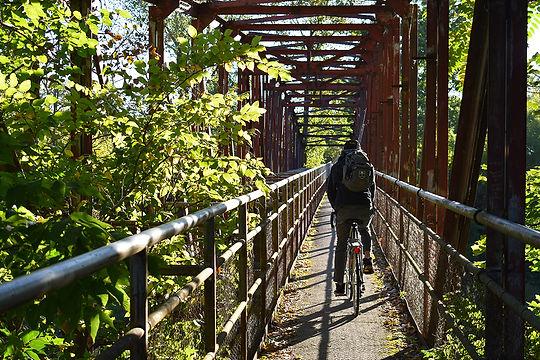 Kid on Bike Crosses River Bridge Piqua.j