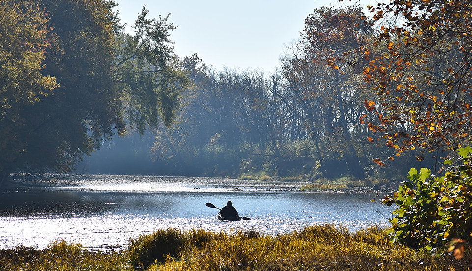Man Canoeing on Great Miami River Wide s