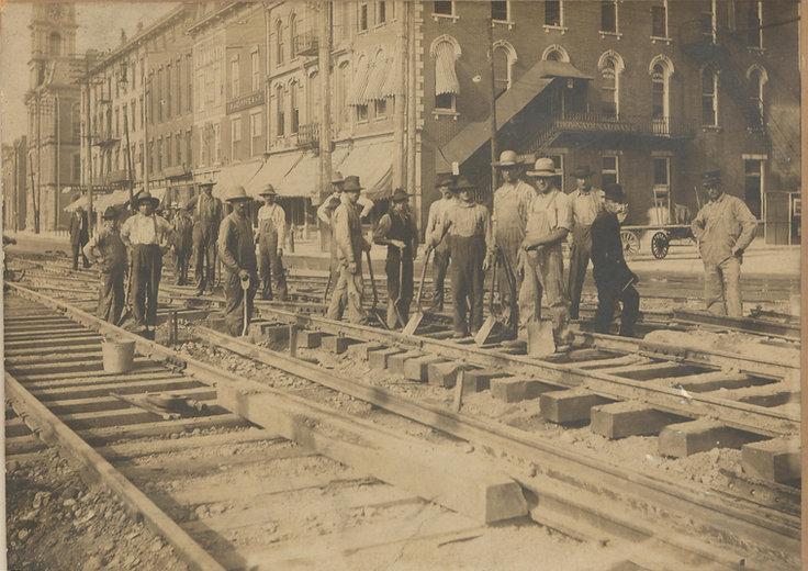 men working in the street in Troy.jpg