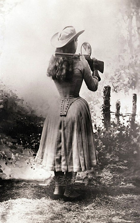 Annie Oakley Shooting Over Her Shoulder