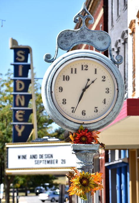 Clock and The Sidney Sign in Sidney.JPG
