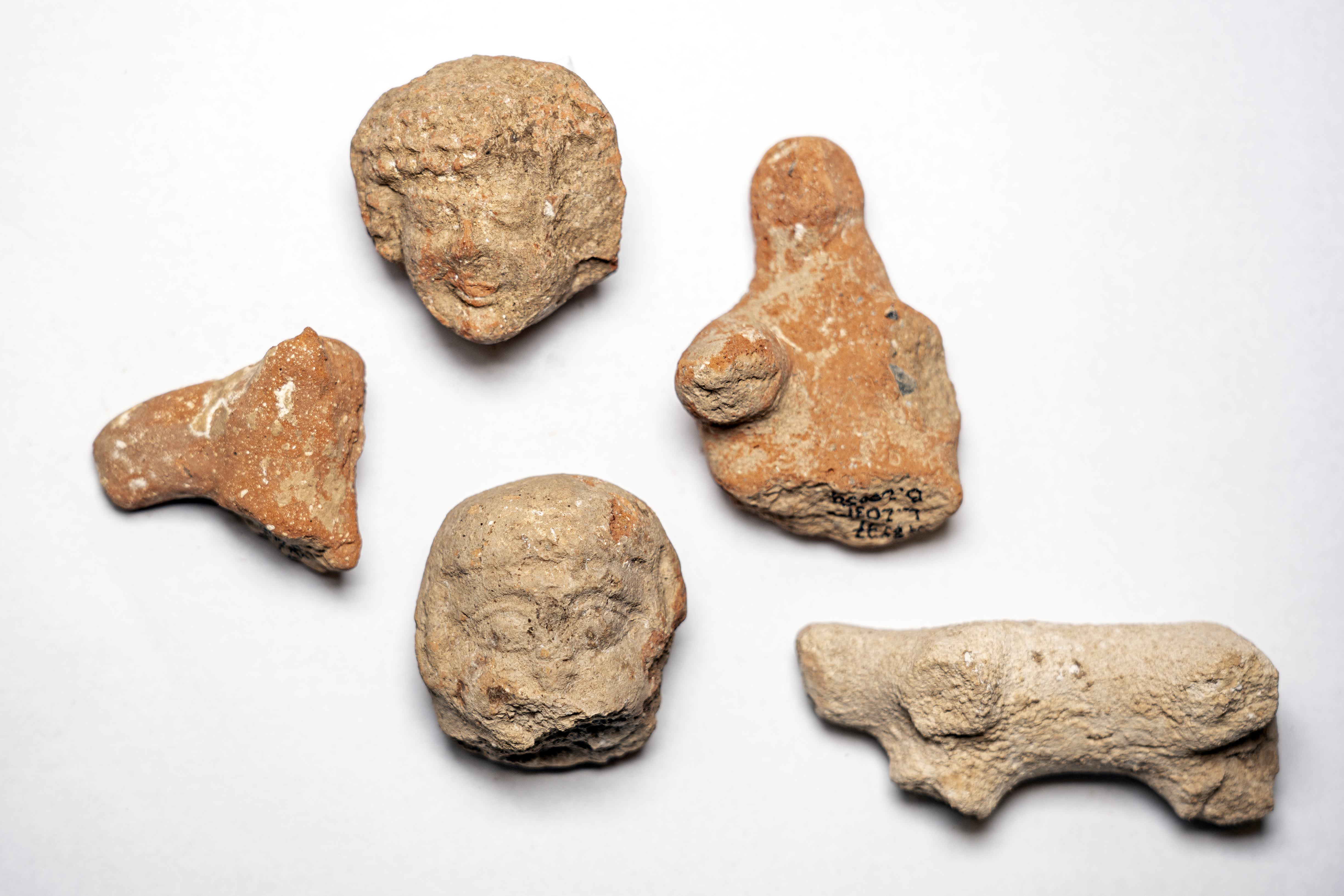 Clay Figurines of Women and Animals Found at the Site. Photography: Yaniv Berman, Israel Antiquities