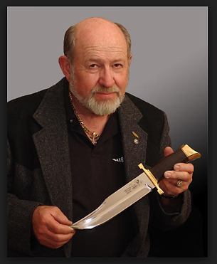 Gil Hibben holding a collecters design knife