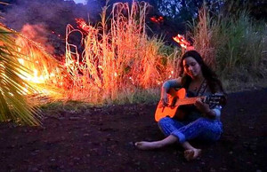 "Kumsa sings ""Burn It Down"" next to the Lava"