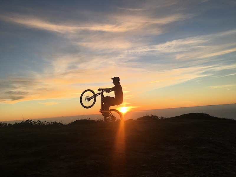Sunset mountain bike riding in California