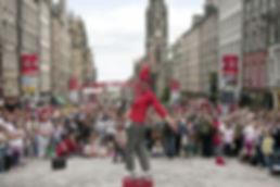 Street entertainers at the Edinburgh Fringe Festival on Edinburgh's Royal Mile High Street