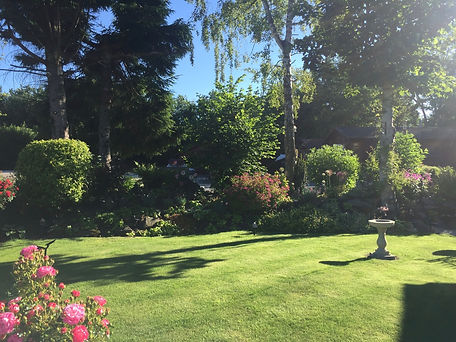 Beautiful garden and lawn at Otter Lodge Auchterarder