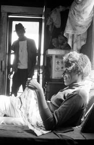 Josie Mae Jones in her home on Clayton Alley in Montgomery, 1967. Her husband, Percy Jones, Jr., is standing in the background.