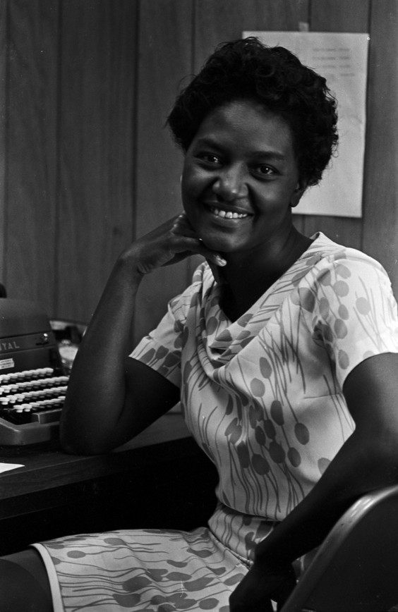 Margaret Dabney at the Southern Courier office in the Frank Leu Building in Montgomery, Alabama. Dabney was a secretary, receptionist, and subscription manager for the Courier. (1965-1968 circa)