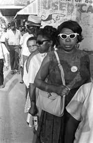 """Marchers in line at a rest stop during the """"March Against Fear"""" through Mississippi, June 1966."""