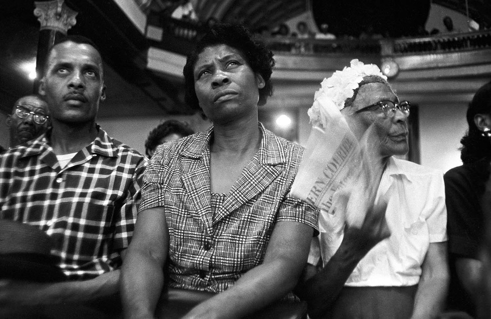 Audience members listening to Martin Luther King Jr. speak at Brown Chapel in Selma, May 1966.