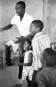 Children speaking at a meeting held during a boycott of the Greenville Training School, 1965.