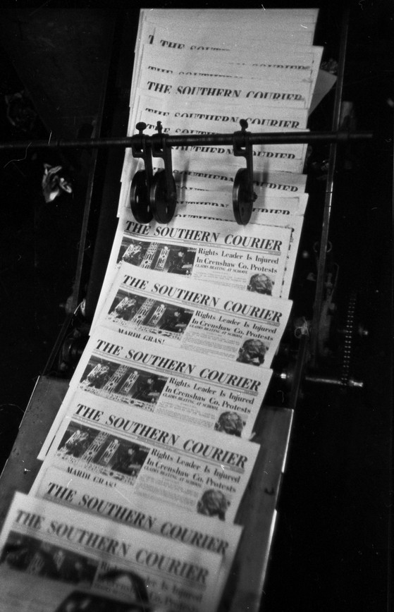 Issues of the Southern Courier on the printing press at the S. E. Publishing Company in Montgomery, Alabama. The Courier was printed by W. Paul Woolley. The issue being printed here is for February 26-27, 1966. (1966 February)