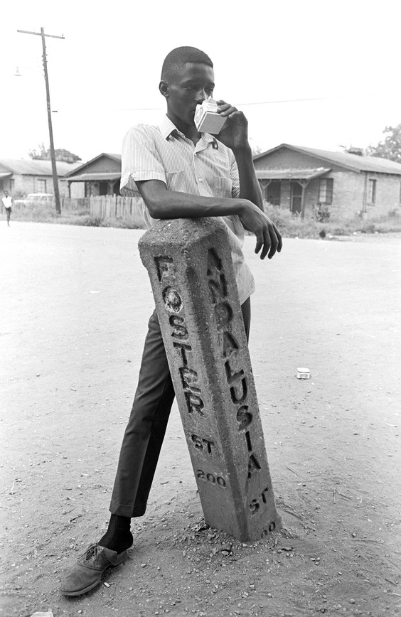 Young man at the intersection of Foster and Andalusia Streets in Newtown, August 1967.