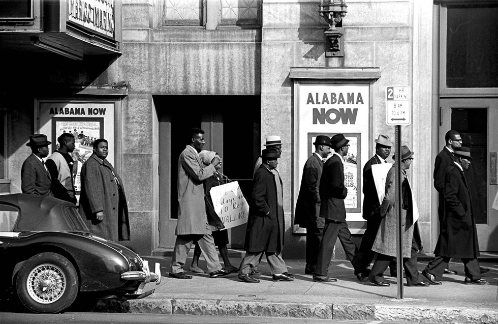 Group marching past the Alabama Theatre in Birmingham during a voter registration drive, 1965.