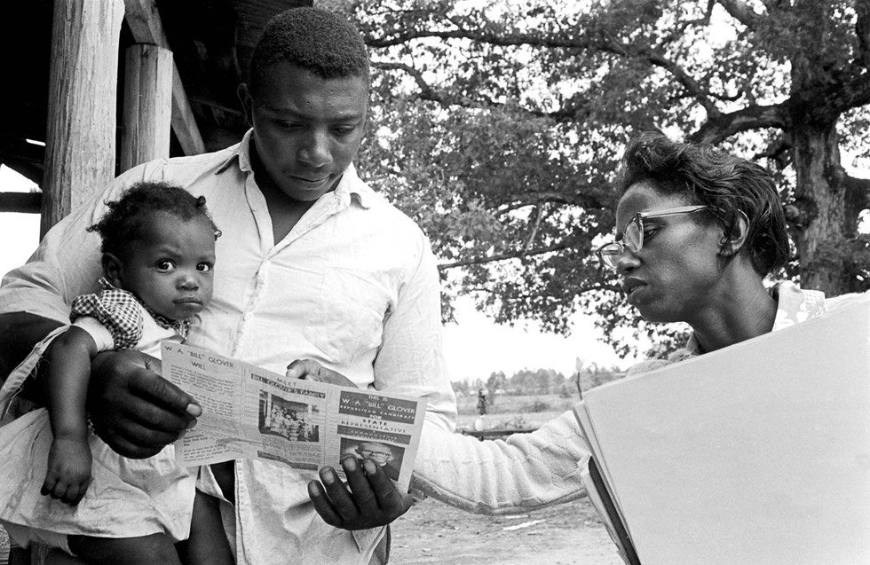 Man reading a brochure during a canvass by the Lowndes County Freedom Organization, 1966.