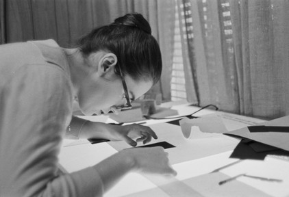 Amy Peppler laying out an issue of the the Southern Courier at the newspaper's office in the Frank Leu Building in Montgomery, Alabama. Peppler, wife of photographer Jim Peppler, was the layout editor for the Courier. (1966-1967 circa)