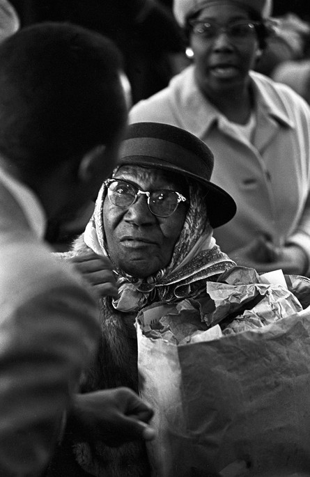 Woman receiving food from the Alabama Action Committee on Christmas day, 1967.
