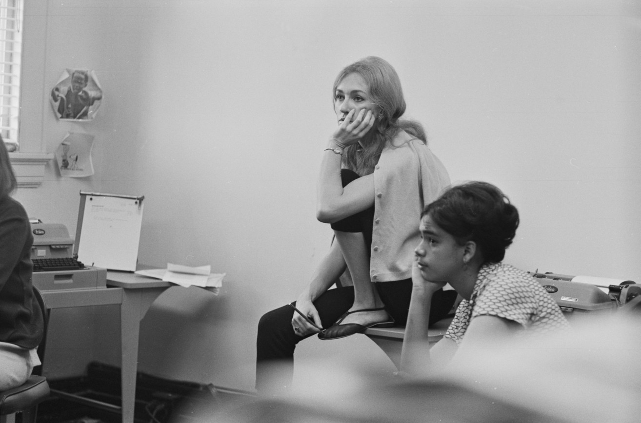 Mary Ellen Gale and Patricia James at a staff meeting at the Southern Courier office in the Frank Leu Building in Montgomery, Alabama. Gale was a reporter for the Courier from 1965 to 1968, and she served as the executive editor from 1966 to July 1968. James was also a reporter for the paper, working from 1966 to 1968. (1966-1967 circa)