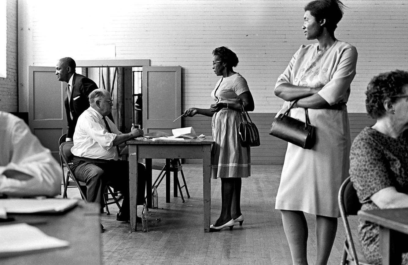 Woman registering to vote with federal examiners in Troy, May 1966.