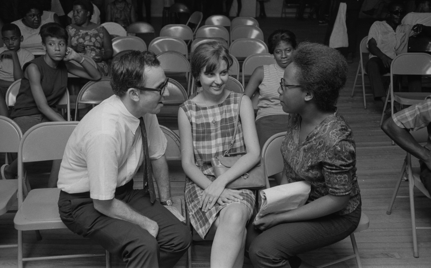 Michael Lottman and Patricia Gorence talking to Sandra Colvin at a meeting of the Montgomery Improvement Association in Montgomery, Alabama. Lottman was a reporter and editor for the Southern Courier from 1965 to 1968; Gorence was a reporter in 1967; Colvin was a reporter from June 1967 to December 1968; and Flowers also held several positions at the paper, including compositor and associate editor. (1967)