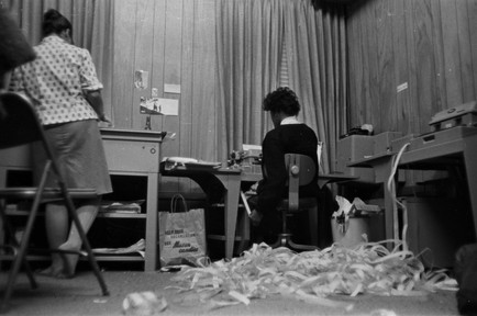 Amy Peppler and Barbara Howard Flowers at the Southern Courier office in the Frank Leu Building in Montgomery, Alabama. Peppler, wife of photographer Jim Peppler, was the layout editor for the Courier. Flowers held several positions at the paper, including compositor and associate editor. (1966-1967 circa)