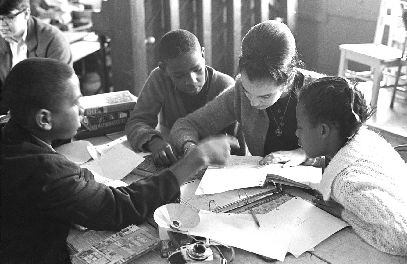 Young woman tutoring students at St. Paul's Lutheran Church in Birmingham, December 1965.