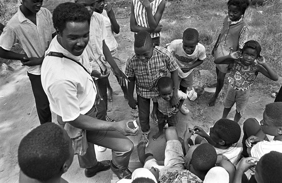 Norman Lumpkin, news director at radio station WRMA, recording children in a neighborhood in Montgomery, circa 1965-1968.