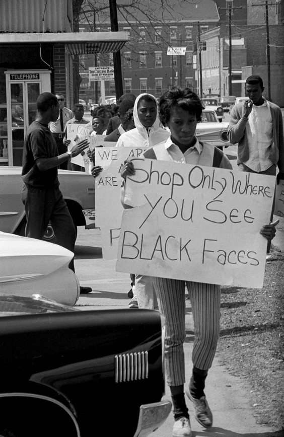 Students carrying signs during a demonstration in downtown Prattville, 1966.