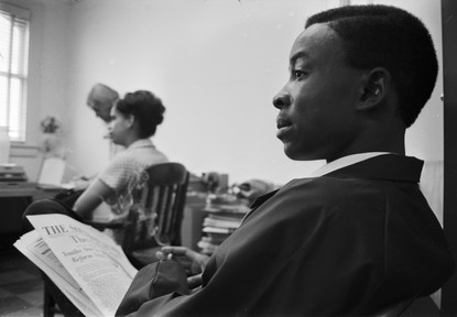 Arlam Carr at a staff meeting at the Southern Courier office in the Frank Leu Building in Montgomery, Alabama. Carr was a reporter for the Courier. (1966-1967 circa)