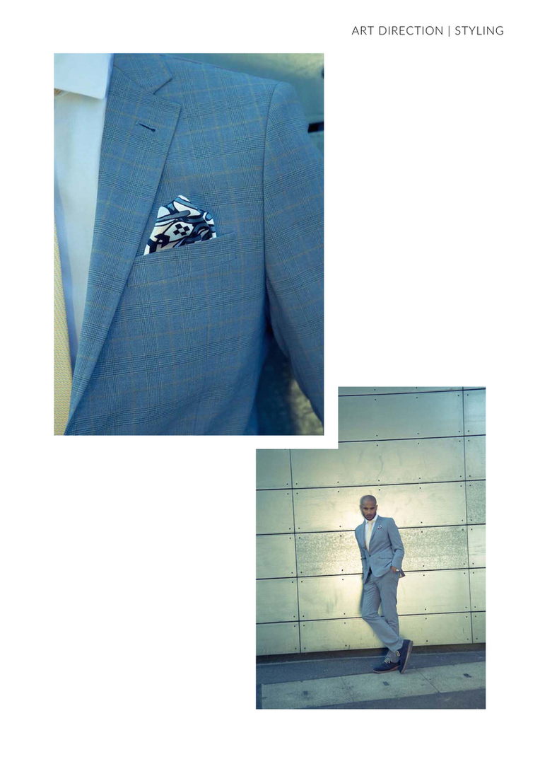 Blue Suit Pocket Square Close Up Man against wall