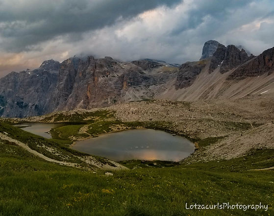 Tre Cime di Lavaredo lake sunset Dolomites Italy