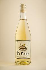 A bottle of Mr. Plūme sweet, non sparkling apple cider