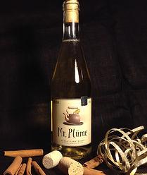 A bottle of Mr. Plūme mulled apple cider