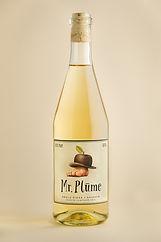 A bottle of Mr. Plūme dry, non sparkling apple cider
