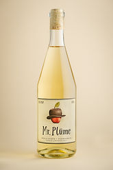 A bottle of Mr. Plūme semi dry, non sparkling apple cider